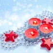 Christmas candles are with baubles on a festive background — Stock Photo #17857383