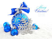 Christmas blue ball is with baubles on snow — Stock Photo