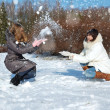 Stock Photo: Two girls in winter throw oneself snow
