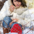 Decorative heart in snow on a background winter girl — Stock fotografie