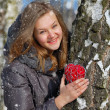 Stock Photo: Winter girl with decorative heart