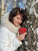 Winter girl with a decorative heart — Stok fotoğraf