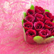 Foto de Stock  : Heart-shaped box with red roses on background wrapping paper