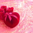 Foto de Stock  : Red velvet Heart-shaped Gift Box with roses on background wrapping paper