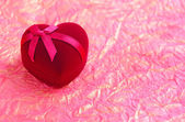 Red velvet Heart-shaped Gift Box on a background a wrapping paper — Stock Photo