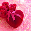 Red velvet Heart-shaped Gift Box with roses on a background a wrapping paper - Stock Photo