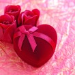 Red velvet Heart-shaped Gift Box with roses on a background a wrapping paper — Stock Photo