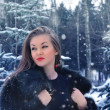 Young woman in winter forest - Stock Photo