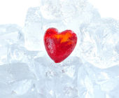 Red heart on ice cubes background — Stock Photo