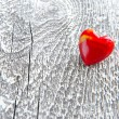 Stock Photo: Valentines Day background. Red heart on wooden background