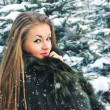 Stock Photo: Young womin winter forest