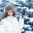 Young woman in winter forest - Foto Stock