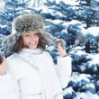 Young woman in winter forest - Photo