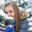 Winter young woman behind snow tree - Stock fotografie