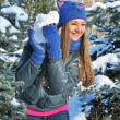 Winter woman play snowballs on snow background — Stockfoto
