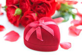 Heart-shaped Gift Box with Red roses on white background — Stock Photo