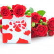 Little gift with red roses on white background — Stock Photo #19830713