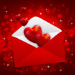 Decorative hearts are in a red postal envelope on a festive back — Stock Photo #19903731