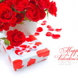 Stock Photo: Little gift with red roses on white background