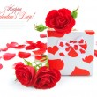Little gift with red roses on white background — Stock Photo