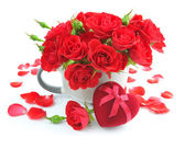 Red roses with Heart-shaped Gift Box on white background — Stock Photo
