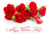 Red roses are with a hearts on a white background — Stock Photo