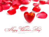 Valentines Day background. Red heart on a background pink petals — Stock Photo