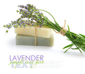 Handmade soap and lavender flowers on a white background — Foto de Stock