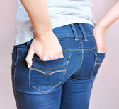 Young girl wearing a pair of jean pants — Stock Photo