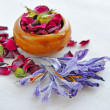 Dry flowers of rose and saffron on sackcloth, herbal medicine — Stock Photo #21525377