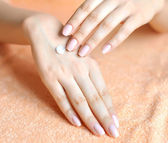 Beautiful woman hands with cream. Skincare concept — Stock Photo