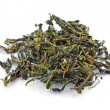 图库照片: Dry herbal tea on a white background