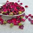 Dry healing flowers and petals on sackcloth, herbal medicine — Stock Photo