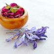 Dry flowers of rose and saffron on sackcloth, herbal medicine — Stock Photo