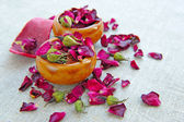 Dry healing flowers and petals in a cups on sackcloth, herbal medicine — Stock Photo