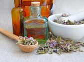 Dry herbal tea Chamerion is with tinctures in bottles on sackcloth, herbal medicine — Foto Stock