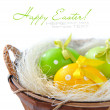 Stock Photo: Easter eggs are in a basket on a white background