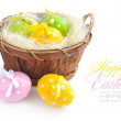 Easter eggs are in a basket on a white background — Stock Photo #22504483