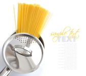 Pasta spaghetti in pot pan on a white background — Stock Photo