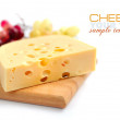 Stock Photo: Piece of cheese on a wooden board on a white background