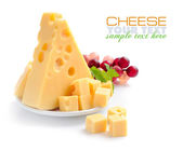 Pieces of cheese on a dish isolated on a white background — Foto de Stock