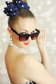Photo of beautiful young woman with sunglasses. Vintage style — Stock Photo