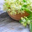 Stock Photo: Flowers of linden tree in wooden bowl