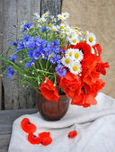 Beautiful bouquet of bright field flowers — Stock Photo