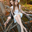 Young beautiful women are in the autumn forest — Stock Photo