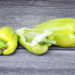Fresh sweet green peppers on an old wooden table — Stock Photo