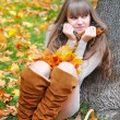 Beautiful girl in the autumn park — Stock Photo #32866631