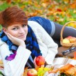 Young pretty womrelaxing in autumn park — Stock Photo #33859271