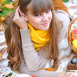 Young pretty womrelaxing in autumn park — Stock Photo #33859273