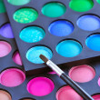 Professional eye shadows palette with makeup brush. Makeup background — Foto de Stock